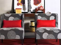 grey fabric upholstered armless accent chairs with red throw