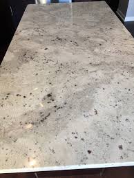 white kitchen cabinets with river white granite river white granite countertops city kitchen bath