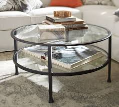round glass cocktail table tanner round coffee table matte iron bronze finish pottery barn