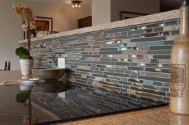 blue glass tile kitchen backsplash with black countertops and a blue brown gray glass mosaic linear tiles backsplash white pictures to