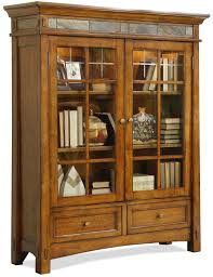 brown wooden books shelves with three shelves and glass doors