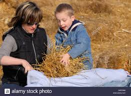 happy little kid boy on a harvest festival painting with colors