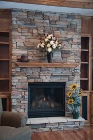 Stacked Stone Around Fireplace by Best 25 Stacked Stone Fireplaces Ideas On Pinterest Stacked