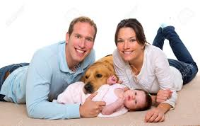 Baby Carpet Baby Mother And Father Happy Family With Golden Retriever Dog