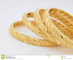 set of gold set of designed gold bangles stock image image of four business