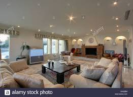 large television screen on floor of modern spanish living room