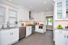 ultimate white kitchen cabinets with white granite countertops