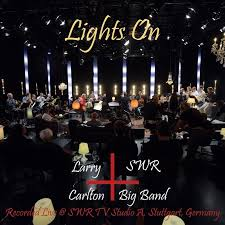 hear lights on a live album by guitarist larry carlton and the