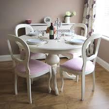 dining room with shabby chic furniture such as table with armless