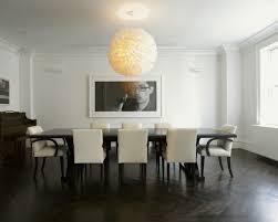 gorgeous dining room near long dark table along near cozy chairs