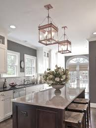 gray kitchen walls with white cabinets traditional kitchen with lanterns www diynetwork co