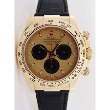 golden rolex rolex cosmograph daytona gold champagne paul newman black strap 116518