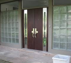 steel and wood double main entryway door house design with frosted