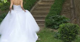 wedding dress no woman in white wedding dress no shoulders fluffy dress is