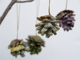 glittered wax dipped pinecone christmas ornaments the magic onions