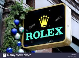 Christmas Decorations Shops London by London England Uk Rolex Sign Outside Shop With Christmas Stock