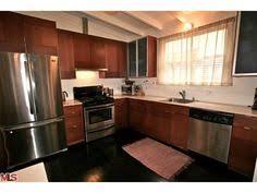 Dark Wood Floor Kitchen by Dark Kitchen Cabinets With Dark Hardwood Floors Kitchen