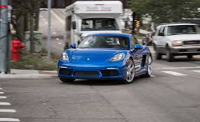 blue porsche 2017 2017 porsche 718 cayman in depth model review car and driver