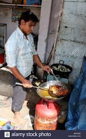 man cooking deep frying indian sweets jalebis near charminar