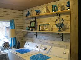 rustic and old laundry room design after makeover with wood wall