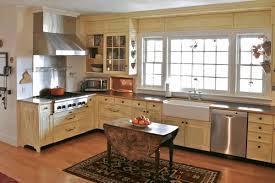 two toned kitchen cabinets beige granite worktop gas range white