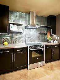 purple kitchen cabinets stone backsplash black gas oven range pull dwon sink chrome