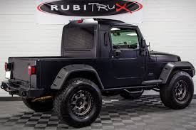 pre owned 2004 jeep wrangler rubitrux conversion flat black
