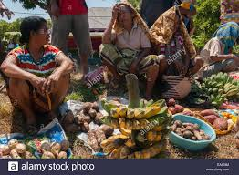 women with their vegetables and fruits to trade at the barter