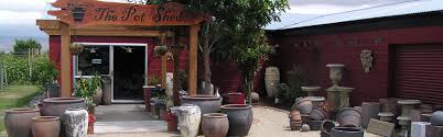the pot shed pots garden ornaments and fresh flowers