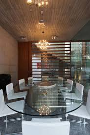 Chandelier India by Glass Dining Table White Chairs Poona House In Mumbai India By