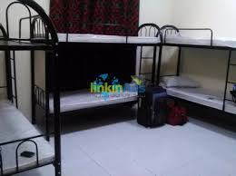 bed space and wooden partition flat rental dubai classified