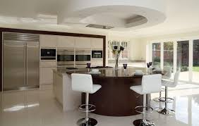 curved breakfast bar kitchen contemporary with built in wall ovens