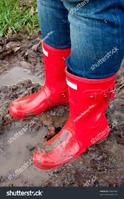 dirty riding boots red rain boots on legs stock photo 67899892 shutterstock