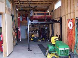 cheap 4 post lift for man toy storage the garage journal board