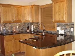 Brown Cabinet Kitchen With Denim Color Backsplash And Wall Color To Match Cabinet