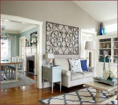 living room with wrought iron wall decor and small sofa