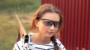 young beautiful in glasses with a gun shooting stock video