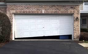 Overhead Door Repair Houston by When To Repair Or Replace Your Garage Door Regency Garage