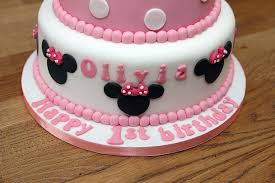 minnie mouse cake with handmade fondant bow ears and minnie mouse