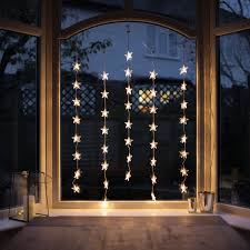 indoor christmas window lights indoor star curtain light with 40 warm white leds on clear cable bay