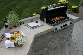stone and tile outdoor kitchen on wood deck archadeck outdoor living