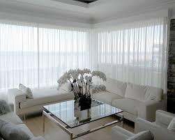 salon haut de gamme rideau et voilage haut de gamme sur mesure décor store signature