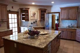 kitchen black grayish countertop on kitchen island and cabinets