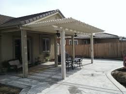 patio unfinished wooden patio roof kit in front of house with