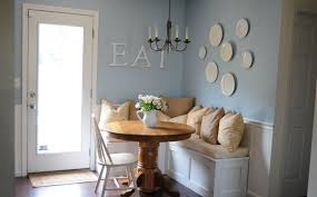 banquette seating design for compact and fashionable gathering simple home banquette seating idea with round wooden table and white chair and wall picture and