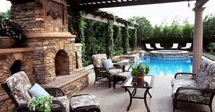stunning outdoor space patio with stone fireplace and gorgeous