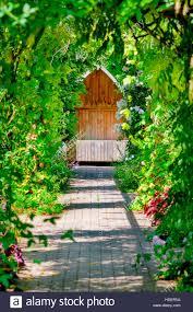 garden trellis walkway hideout hidden tranquil sitting bench area