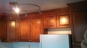 how to install cabinets with uneven ceiling kitchen cabinets crown install w uneven toprail