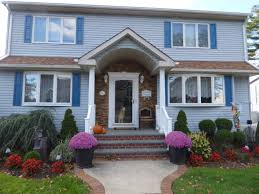 front entrance design in only 2 days creative faux panels after a home s front entrance re sided with stacked stone style panels