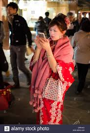 Cool Stock by Young Japanese Wearing A Flowery Red Winter Kimono On A Cool